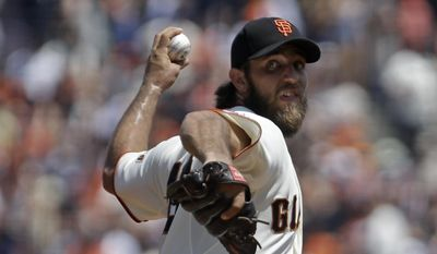 San Francisco Giants pitcher Madison Bumgarner works against the Washington Nationals in the first inning of a baseball game Sunday, Aug. 16, 2015, in San Francisco. (AP Photo/Ben Margot)