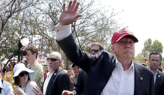 Republican presidential candidate Donald Trump waves to the crowd at the Iowa State Fair in Des Moines on Aug. 15, 2015. (Associated Press)
