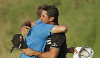 Jason Day, of Australia, gets a hug from Jordan Spieth after winning the PGA Championship golf tournament Sunday, Aug. 16, 2015, at Whistling Straits in Haven, Wis. (AP Photo/Chris Carlson)