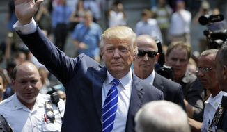 Donald Trump waves as he leaves for lunch after being summoned for jury duty in New York on Aug. 17, 2015. Trump was due to report for jury duty Monday in Manhattan. The front-runner said last week before a rally in New Hampshire that he would willingly take a break from the campaign trail to answer the summons. (Associated Press)