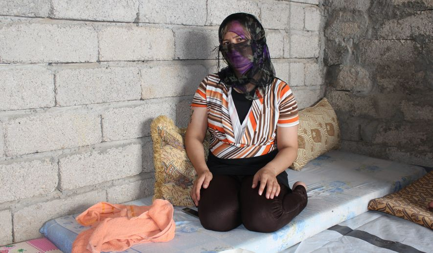 """A Yazidi woman captured by the Islamic State and rescued by Khalil Dakhi 11 months later said the militants """"beat me, raped me, handcuffed me and left me in a room for days. I tried to kill myself by jumping from a tall building and by electrocuting myself."""" (Florian Neuhof/Special to The Washington Times) ** FILE **"""