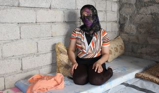 "A Yazidi woman captured by the Islamic State and rescued by Khalil Dakhi 11 months later said the militants ""beat me, raped me, handcuffed me and left me in a room for days. I tried to kill myself by jumping from a tall building and by electrocuting myself."" (Florian Neuhof/Special to The Washington Times) ** FILE **"