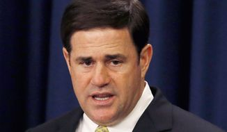 Gov. Doug Ducey speaks to the Classrooms First Initiative Council Group and the gathered audience at the first meeting as the council works to improve educational outcomes through school finance reform Friday, June 26, 2015, in Phoenix. (AP Photo/Ross D. Franklin)