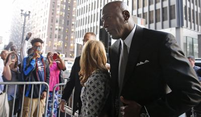 Basketball Hall of Famer Michael Jordan arrives at the federal courthouse in Chicago, Tuesday, Aug. 18, 2015. Jordan is expected to take the stand in his case against a now-defunct grocery store chain that used his image without permission. (AP Photo/Christian K. Lee)
