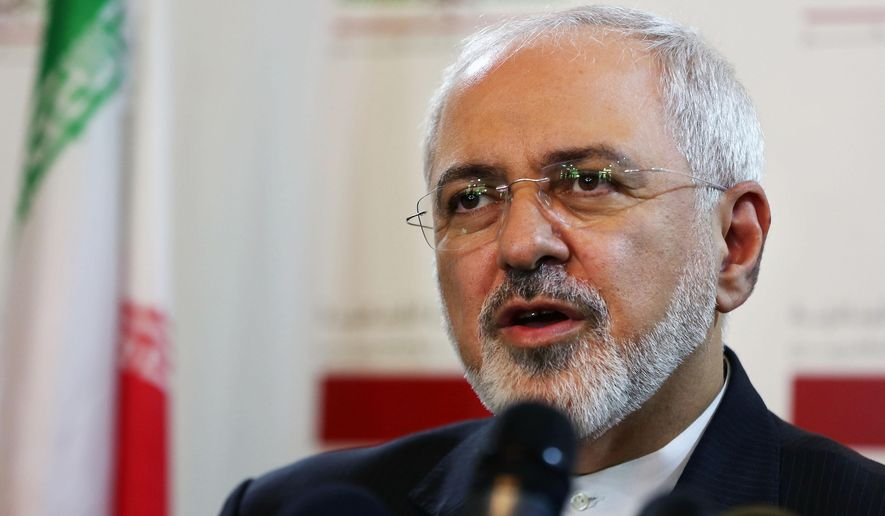 A Wednesday, Aug. 12, 2015 photo from files showing Iranian Foreign Minister Mohammad Javad Zarif, during a press conference at the Lebanese foreign ministry in Beirut, Lebanon. An unusual secret agreement with a U.N. agency will allow Iran to use its own experts to inspect a site allegedly used to develop nuclear arms, according to a document seen by The Associated Press. (AP Photo/Bilal Hussein, File)