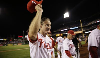 Chase Utley acknowledges cheers from the crowd as he walks off the field after the Phillies' 7-4 win over the Toronto Blue Jays in Philadelphia. Utley was traded to the Los Angeles Dodgers on Wednesday night for two minor leaguers. (Associated Press)