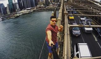 David Karnauch of Chattanooga, 21, was arrested in his home state Monday after he climbed a beam atop New York City's Brooklyn Bridge to snap a selfie. (David Karnauch via Callie Starnes)