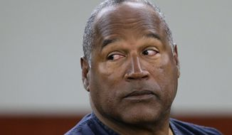 O.J. Simpson appears at an evidentiary hearing in Clark County District Court in Las Vegas on May 13, 2013. The former football star appeared in Hertz ads for more than a decade and came to be associated with the rental car company. Simpson had continued making appearances at events for the company. That ended in 1994 when he was charged with first-degree murder of ex-wife Nicole Brown and friend Ronald Goldman. (Associated Press) **FILE**