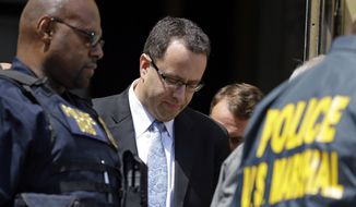 Former Subway pitchman Jared Fogle leaves the Federal Courthouse in Indianapolis, Wednesday, Aug. 19, 2015 following a hearing on child-pornography charges. Fogle agreed to plead guilty to allegations that he paid for sex acts with minors and received child pornography in a case that destroyed his career at the sandwich-shop chain and could send him to prison for more than a decade.  (AP Photo/Michael Conroy)