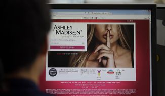 A June 10, 2015, file photo shows Ashley Madison's Korean website on a computer screen in Seoul, South Korea. (AP Photo/Lee Jin-man, File)
