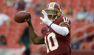 Washington Redskins quarterback Robert Griffin III warms up before a preseason game Thursday against the Detroit Lions in Landover, Md. (Associated Press)