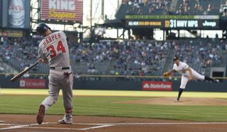 Washington Nationals' Bryce Harper connects for a single off Colorado Rockies starting pitcher Jorge De La Rosa during the first inning of a baseball game Wednesday, Aug. 19, 2015, in Denver. (AP Photo/David Zalubowski)