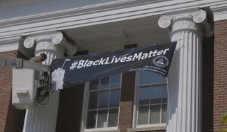 """City officials in Somerville, Massachusetts, displayed a banner proudly declaring """"#BlackLivesManner"""" in front of City Hall on Wednesday morning. (Boston Globe screengrab)"""