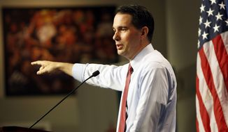Republican presidential candidate, Wisconsin Gov. Scott Walker speaks during a campaign stop called Politics and Eggs with business leaders and political activist, Friday, Aug. 21, 2015, in Manchester, N.H. (AP Photo/Jim Cole) ** FILE **