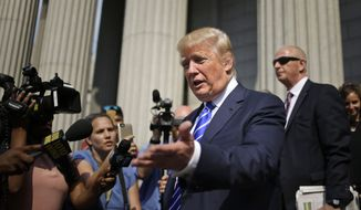 Republican presidential candidate Donald Trump leaves the courthouse after serving on jury duty in New York, Monday, Aug. 17, 2015. The Republican presidential candidate reported for jury duty in Manhattan on Monday and spent much of the day like everyone else, filling out forms and wondering whether he would get picked. (AP Photo/Seth Wenig)