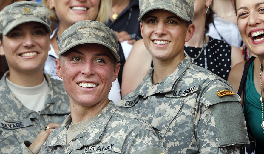 U.S. Army First Lt. Shaye Haver (center) and Capt. Kristen Griest (right) pose for photos with other female West Point alumni after an Army Ranger school graduation ceremony at Fort Benning, Ga., on Aug. 21, 2015. Haver and Griest became the first female graduates of the Army's rigorous Ranger School, putting a spotlight on the debate over women in combat. (Associated Press) **FILE**