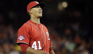 Washington Nationals starting pitcher Joe Ross (41) reacts during play as he pitches a baseball game against the Milwaukee Brewers at Nationals Park in Washington, Saturday, Aug. 22, 2015. (AP Photo/Jacquelyn Martin)