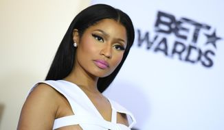 In this June 28, 2015, file photo, Nicki Minaj, winner of viewers choice and best female hip-hop artist awards, poses in the press room at the BET Awards at the Microsoft Theater in Los Angeles. Madame Tussauds says employees at the Las Vegas museum will be closely monitoring a wax figure of Minaj after an image of a visitor posing suggestively with the statue appeared on social media. (Photo by Richard Shotwell/Invision/AP)