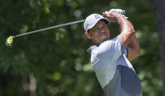Tiger Woods tees off on the second hole during the third round of the Wyndham Championship golf tournament at Sedgefield Country Club in Greensboro, N.C., Saturday, Aug. 22, 2015. (AP Photo/Rob Brown)