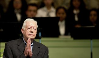 Former President Jimmy Carter teaches Sunday School class at Maranatha Baptist Church in his hometown Sunday, Aug. 23, 2015, in Plains, Ga. The 90-year-old Carter gave one lesson to about 300 people filling the small Baptist church that he and his wife, Rosalynn, attend. It was Carter's first lesson since detailing the intravenous drug doses and radiation treatment planned to treat melanoma found in his brain after surgery to remove a tumor from his liver. (AP Photo/David Goldman)