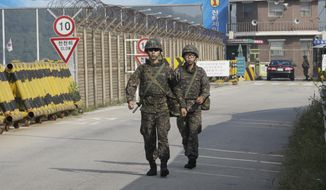 South Korean amy soldiers walk on Unification Bridge, which leads to the demilitarized zone, near the border village of Panmunjom in Paju, South Korea, Sunday, Aug. 23, 2015. (AP Photo/Ahn Young-joon) ** FILE **