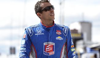 Justin Wilson, of England, walks on pit road during qualifying for Sunday's Pocono IndyCar 500 auto race, Saturday, Aug. 22, 2015, in Long Pond, Pa. Wilson was injured during Sunday's race and air lifted to the hospital. (AP Photo/Derik Hamilton)