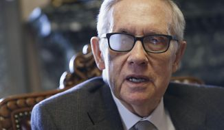 "This March 4, 2015, file photo shows Senate Minority Leader Harry Reid of Nev. talking about his future and the agenda of the Democrats who are now in the minority, during an interview in Washington. Reid says he's throwing his full support behind President Barack Obama's nuclear agreement with Iran. In a message on his Twitter account, the Nevada senator said Sunday, Aug. 23, 2015, he strongly supports ""the historic agreement with Iran and will do everything in my power to ensure that it stands."" Reid was wearing special glasses as part of his recovery from injuries suffered in a violent exercise accident in January.  (AP Photo/J. Scott Applewhite, File)"