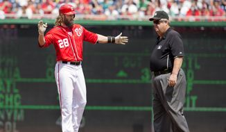 Washington Nationals Jayson Werth (28) reacts after hitting a double during the first inning of a baseball game against the Milwaukee Brewers at Nationals Park in Washington, Sunday, Aug. 23, 2015. At right is second base umpire Joe West (22). (AP Photo/Jacquelyn Martin)