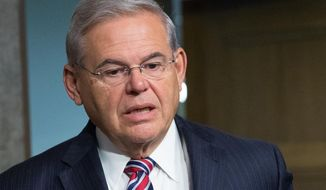 In the photo taken July 23, 2015, Sen. Bob Menendez, D-N.J. is seen on Capitol Hill, in Washington. Florida eye doctor Dr. Salomon Melgen,  linked to Menendez in a corruption case is seeking changes in his bond conditions in an unrelated Medicare fraud prosecution. (AP Photo/Andrew Harnik) **FILE**