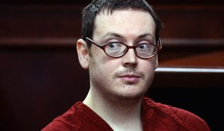 James Holmes appears in court for the sentencing phase in his trial, Monday, Aug. 24, 2015, at Arapahoe County District Court in Centennial, Colo. Victims and their families were given the opportunity to speak about the shooting and its effects on their lives. (RJ Sangosti/The Denver Post via AP, Pool)