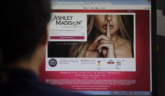 A June 10, 2015, file photo shows Ashley Madison's Korean website on a computer screen in Seoul, South Korea. (AP Photo/Lee Jin-man/ File)