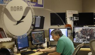 Jack Beven, senior hurricane specialist, tracks the movement of Tropical Storm Erika as it moves westward towards islands in the eastern Caribbean, at the National Hurricane Center, Wednesday, Aug. 26, 2015, in Miami. Hurricane Fred is the first to actually pass over the Cape Verde Islands as a hurricane. (AP Photo/Lynne Sladky)