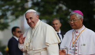 Pope Francis, left, waves during his visit to the birthplace of Saint Kim Taegon Andrea, also known as Saint Andrew Kim Taegon, the first Korean-born Catholic priest, prior to a meeting with Asian youths at the Solmoe Sanctuary in Dangjin, South Korea, Friday, Aug. 15, 2014. (AP Photo/Issei Kato, Pool) ** FILE **