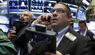 Trader Robert Oswald, right, works on the floor of the New York Stock Exchange, Wednesday, Aug. 26, 2015. U.S. stocks are opening sharply higher Wednesday after slumping for six straight days amid concern that growth in China was slowing more quickly than previously thought. (AP Photo/Richard Drew)