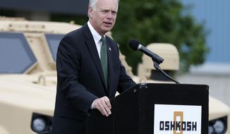 Sen. Ron Johnson speaks during a press conference to announce that the United States Army has awarded Oshkosh Defense a $6.7 billion contract to build the Humvee's replacement, Oshkosh Corp's Joint Light Tactical Vehicle, or JLTV, Wednesday, Aug. 26, 2015, in Oshkosh, Wis. (Wm.Glasheen /The Post-Crescent via AP) NO SALES; MANDATORY CREDIT