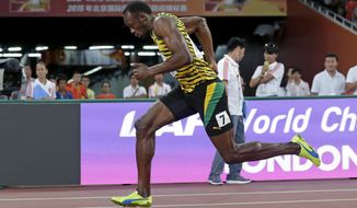 Jamaica's Usain Bolt races in a men's 200m semifinal at the  at the World Athletics Championships at the Bird's Nest stadium in Beijing, Wednesday, Aug. 26, 2015. (AP Photo/Andy Wong)