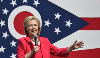 Democratic presidential candidate Hillary Rodham Clinton speaks on the campus of Case Western Reserve University in Cleveland, Thursday, Aug. 27, 2015, during a 'Commit to Vote' grassroots organizing meeting. (AP Photo/David Richard)