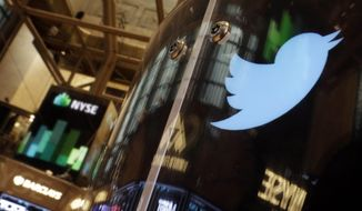 In this Nov. 6, 2013, file photo, the Twitter bird logo is on an updated phone post on the floor of the New York Stock Exchange. (AP Photo/Richard Drew) ** FILE **