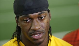 Washington Redskins quarterback Robert Griffin III talks to reporters after NFL football practice, Tuesday, Aug. 18, 2015 in Ashburn, Va. (AP Photo/Alex Brandon)