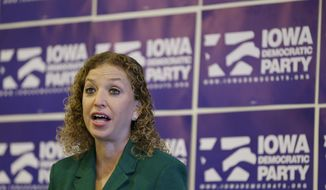 Democratic National Committee Chairwoman, Rep. Debbie Wasserman Schultz, D-Fla. speaks during a news conference in Des Moines, Iowa. (AP Photo/Charlie Neibergall, File)