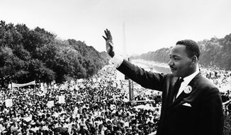 """The Rev. Martin Luther King Jr., standing before 250,000 in front of the Lincoln Memorial on Aug. 28, 1963, to give his """"I Have a Dream"""" speech."""