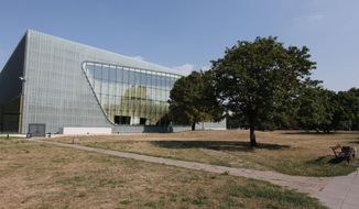 This photo from Aug. 12 2015, shows the POLIN Museum of the History of Polish Jews in Warsaw, Poland. A Polish-American Holocaust survivor, Sigmund Rolat, plans to build a memorial to the thousands of Polish gentiles who rescued Jews during the war in this park next to the museum, an area in the heart of the former Warsaw Ghetto.  (AP Photo/Czarek Sokolowski)
