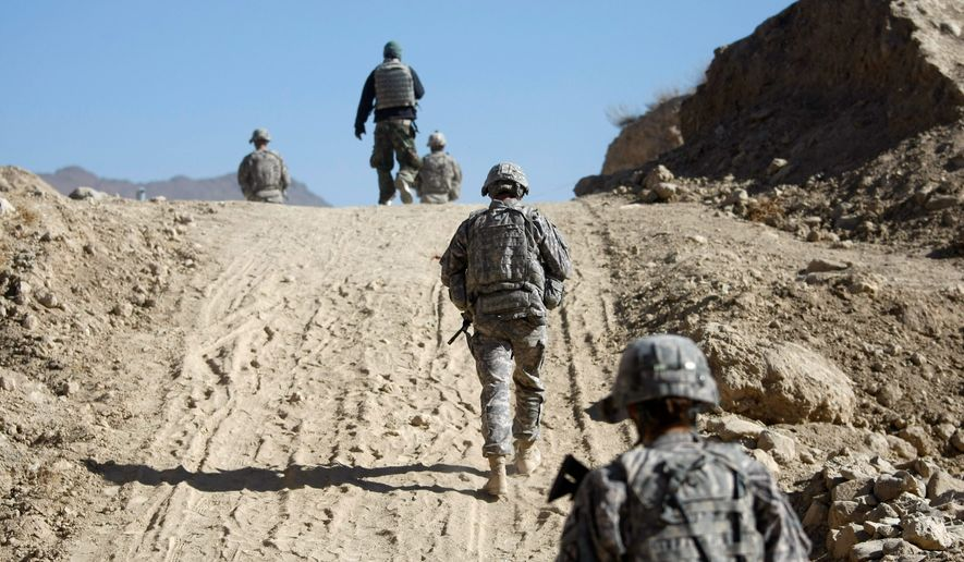 """Army Special Forces operating in Afghanistan have been disciplined, admonished and even fired for actions that the U.S. soldiers firmly believe are part of their duty to """"free the oppressed,"""" as the Green Beret motto says. (Associated Press)"""
