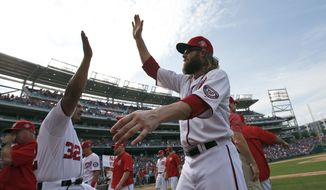 Washington Nationals' Jayson Werth, right, celebrates with first base coach Tony Tarasco (32) after a baseball game against the Miami Marlins at Nationals Park, Sunday, Aug. 30, 2015, in Washington. The Nationals won 7-4. (AP Photo/Alex Brandon)