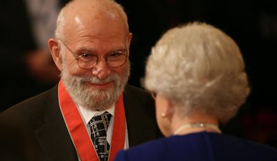"FILE - This is a  Nov. 26, 2008 file photo of  Dr Oliver Sacks, receiving his Commander of the Order of the British Empire (CBE ), by  Britain's Queen Elizabeth II at Buckingham Palace, London. Dr. Oliver Sacks, whose books like ""The Man Who Mistook His Wife For a Hat"" probed distant ranges of human experience by compassionately portraying people with severe and sometimes bizarre neurological conditions, has died. He was 82 .Sacks died Sunday at his home in New York City, his assistant, Kate Edgar, said. (Lewis Whyld/PA via AP) UNITED KINGDOM OUT"