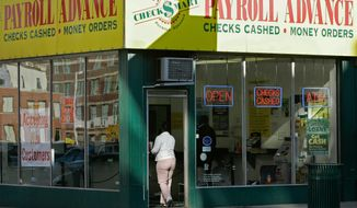 """The majority of payday lending customers interviewed say they know what they are walking into when they take out loans. Despite the high interest rates, they say the services have helped them get by financially. Many of them say they are """"too proud to beg."""" (Associated Press)"""