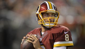 Washington Redskins quarterback Kirk Cousins warms up on the sideline during an NFL preseason football game against the Cleveland Browns Thursday, Aug. 13, 2015, in Cleveland. Washington won 20-17. (AP Photo/David Richard)