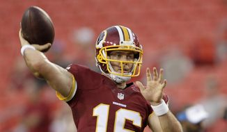 In this photo taken Aug. 20, 2015, Washington Redskins quarterback Colt McCoy (16) warms up before an NFL preseason football game against the Detroit Lions, in Landover, Md. Kirk Cousins will start the season as Washington's quarterback, Redskins coach Jay Gruden said Monday. With Robert Griffin III still in the NFL's concussion protocol program, Gruden opted for Cousins, who was drafted along with Griffin in 2012 and has started nine games when Griffin has been hurt, going 2-7. (AP Photo/Mark Tenally)