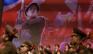 Researchers have issued a correction in a 2012 study which previously found conservatives to be more genetically prone to authoritarianism. | In this photo taken Monday, Aug. 31, 2015, the North Korean male choir performs at the Tchaikovsky Concert Hall in Moscow, Russia.  (AP Photo/Pavel Golovkin)
