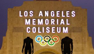 FILE - This Feb. 13, 2008, file photo shows the facade of The Los Angeles Memorial Coliseum in Los Angeles. The Los Angeles City Council cleared the way Tuesday, Sept. 1, 2015, for Mayor Eric Garcetti to strike agreements for a 2024 Olympics bid, putting the city on the verge of becoming the U.S. contender after Boston's awkward collapse. (AP Photo/Damian Dovarganes, File)
